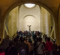Trippers admire winged victory of samothrace also called the ni paris april tourists walk in museum louvre on april in paris Stock Photos