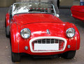 Triumph tr british car vintage britich on red shiny color this sports from was produced between and by standard in Royalty Free Stock Photography