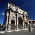 Triumphal arch of constantine in rome italy and coliseum background at Royalty Free Stock Images
