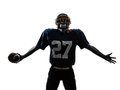 Triumphant american football player man silhouette one caucasian in studio isolated on white background Stock Photo