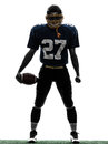 Triumphant american football player man silhouette one caucasian in studio isolated on white background Stock Images