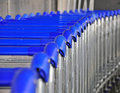 Trolleys in airport blue the Royalty Free Stock Images