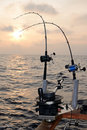 Trolling fishing at sunset Stock Photography