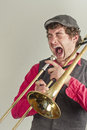 Trombone musician yelling jazz has had enough of his rusty Royalty Free Stock Image