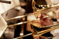 Trombones Playing in a Big Band (shallow focus). Royalty Free Stock Photo