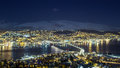 Tromso city night panorama, view from the mountains towards bridge and Arctic Cathedral Royalty Free Stock Photo