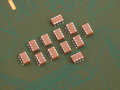 Troop of ceramic capacitors group on pcb board Stock Photo