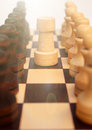 Troop pawns and rook on chessboard squad black white figures stand in row front of each other in the middle selective focus close Stock Photos