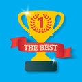 Trophy cup with shadow. Icon gold goblet, medieval goblet with ribbon and text the best. Symbol cup champion on blue Royalty Free Stock Photo