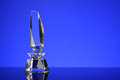 Trophy glass in blue background Royalty Free Stock Image