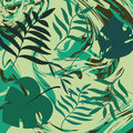 Tropic backgound. Tropical leaves on green marble texture. Design template. Royalty Free Stock Photo