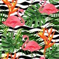 Tropical background with exotic plants and flamingo. Seamless pattern.