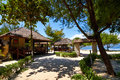 Tropical beach bungalow on ocean shore gili meno lombok indonesia Stock Photo