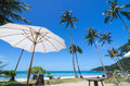 Tropical beach with coconut palm and beautiful umbrella sa mui island south of thailand Royalty Free Stock Photo