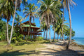 Tropical beach house with coconut trees palm on an island in the caribbean Royalty Free Stock Image