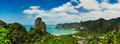 Tropical beach landscape panorama beautiful railay west beach rock formations blue ocean hotel resorts under sky high view point Stock Photos