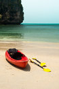Tropical beach landscape with red canoe boat at ocean gulf under blue sky pranang cave railay krabi thailand Stock Image
