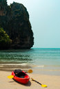 Tropical beach landscape with red canoe boat at ocean gulf under blue sky pranang cave railay krabi thailand Royalty Free Stock Photo