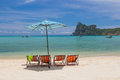 Tropical beach landscape with sunbeds and umbrella on ko phi phi island thailand Royalty Free Stock Photos