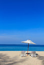 Tropical beach landscape with sunbeds and umbrella on phuket island thailand Royalty Free Stock Image