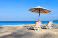 Tropical beach landscape with sunbeds and umbrella on phuket island thailand Stock Image