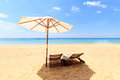 Tropical beach landscape with sunbeds and umbrella on phuket island thailand Royalty Free Stock Photos