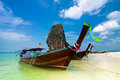 Tropical beach landscape thai traditional long tail boats ocean gulf under blue sky pranang cave beach railay krabi thailand Stock Photos