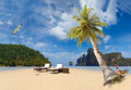 Tropical beach of phi phi island ko don with sunbeds and long tailed boat Stock Image