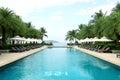 Tropical beach resort hotel swimming pool Royalty Free Stock Photo