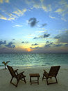 Tropical beach resort the maldives sunset at a luxury in paradise of Stock Images