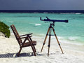 Tropical beach resort the maldives telescope on a on a island in Royalty Free Stock Images