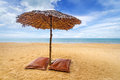 Tropical beach scenery with parasol and beds in thailand Stock Photo