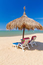 Tropical beach scenery with parasol and deck chairs in thailand Stock Image