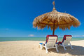 Tropical beach scenery with parasols Royalty Free Stock Images