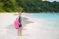 Tropical beach similan islands tachai island andaman sea thai woman standing with dry bag thailand Stock Photos