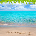 Tropical beach with Summer word written in sand Royalty Free Stock Photo
