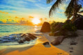 Tropical beach at sunset Royalty Free Stock Photo