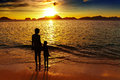 Tropical beach at sunset mother and daughter on the el nido philippines Stock Photo