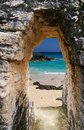 Tropical beach view from an archway leading to a secluded Stock Photography