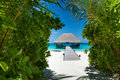 Tropical beach with wooden house at Maldives Royalty Free Stock Photo