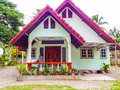 Tropical bungalow home with flower pots on the beach Royalty Free Stock Images