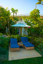 Tropical chaise lounge setting lounges rest open at a resort Stock Image