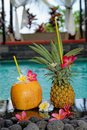 Tropical cocktails pool nicely decorated coconut pineapple cocktails pool side luxury villa bali island Royalty Free Stock Photo