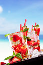 Tropical drinks mojito on wood with blur beach on background Stock Photos