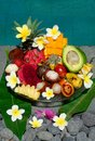 Tropical exotic fruits basket exotic fruits bali indonesia swimming pool Royalty Free Stock Image