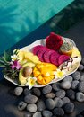 Tropical exotic fruits basket exotic fruits bali indonesia swimming pool Royalty Free Stock Photos