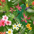Tropical Floral Seamless Pattern with Dragonflies. Nature Background with Palm Tree Leaves and Exotic Flowers