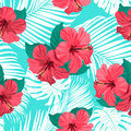 Tropical flowers and palm leaves on background. Seamless. Royalty Free Stock Photo