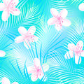 Tropical frangipani hibiscus with blue palms seamless pattern Royalty Free Stock Photo
