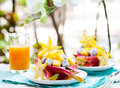 Tropical fruit salad in pitahaya, mango, dragon fruit bowls with a glass of juice Royalty Free Stock Photo